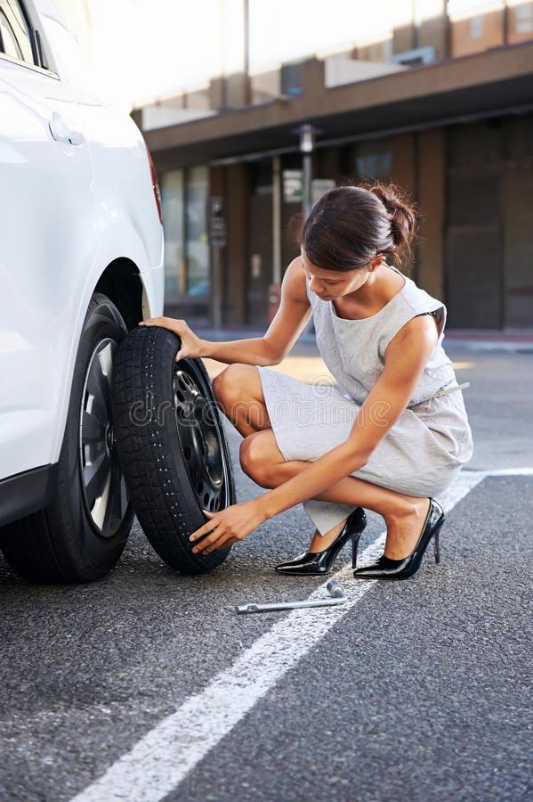 Flat tire woman stock photography