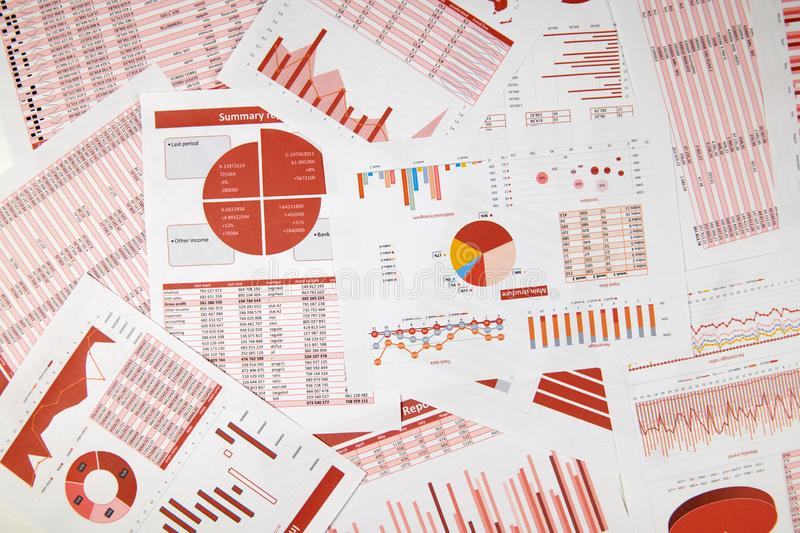 Flat top view of business workspace - reports with data, tables and analytic chart. Business financial accounting concept stock photography