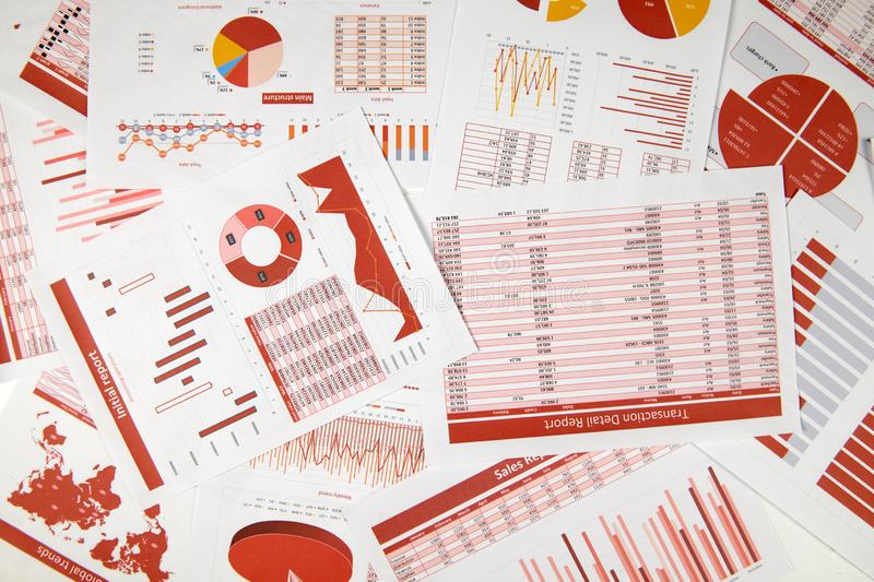 Flat top view of business workspace - reports with data, tables and analytic chart. Business financial accounting concept stock image