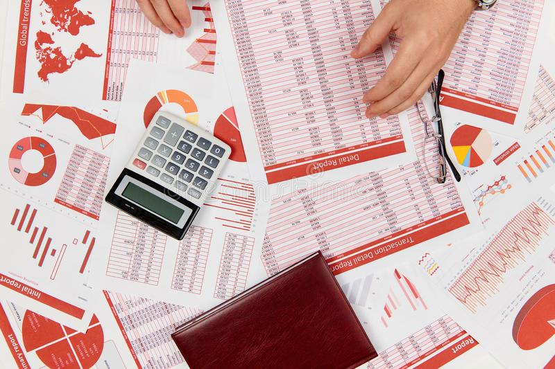 Flat top view of businessman working and calculating finance, reads and writes reports. Business financial accounting concept stock photo