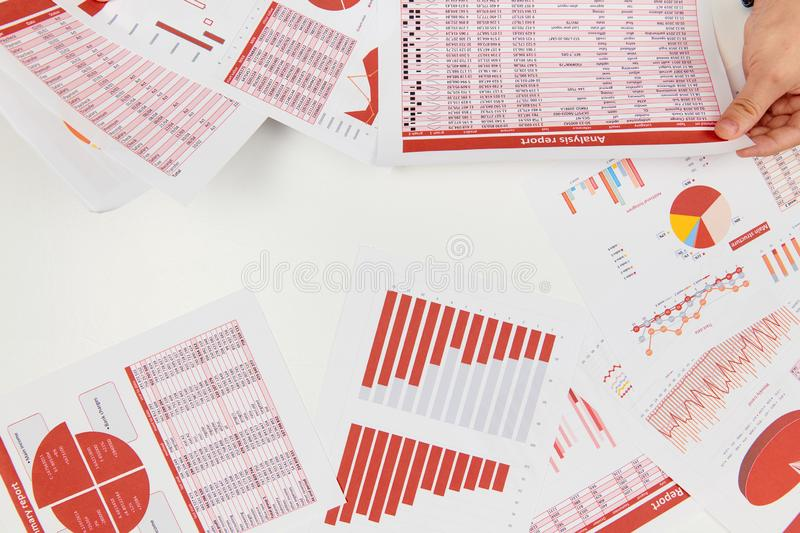Flat top view of businessman working and calculating finance, reads and writes reports. Business financial accounting concept stock images