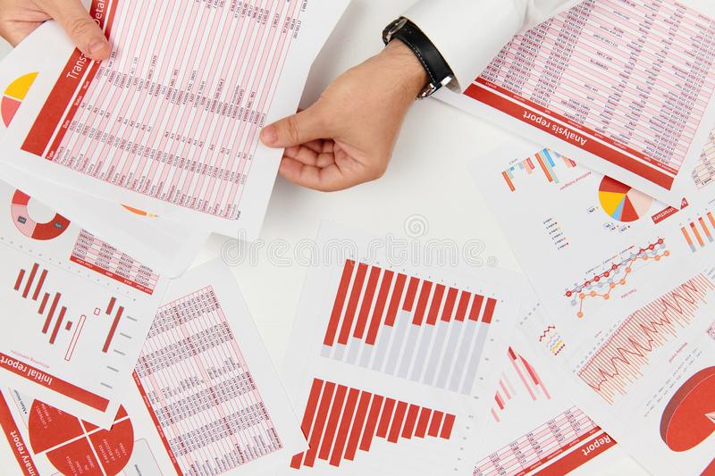 Flat top view of businessman working and calculating finance, reads and writes reports. Business financial accounting concept royalty free stock photography