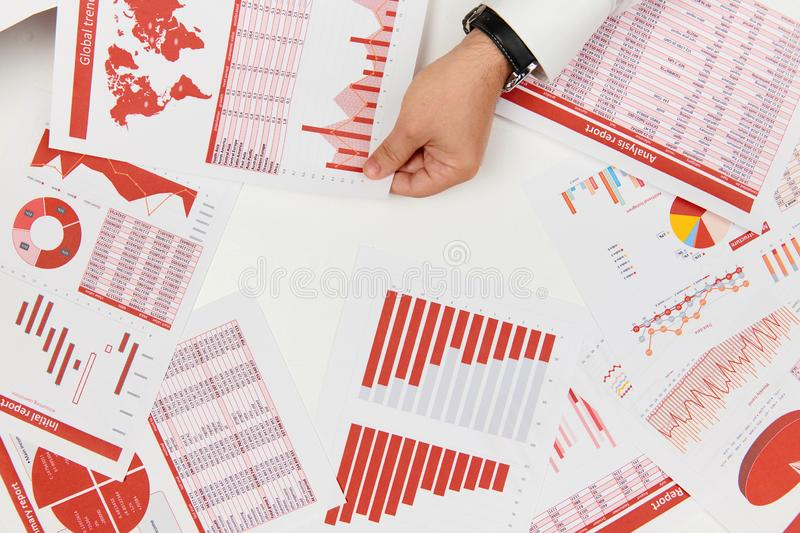 Flat top view of businessman working and calculating finance, reads and writes reports. Business financial accounting concept stock photos