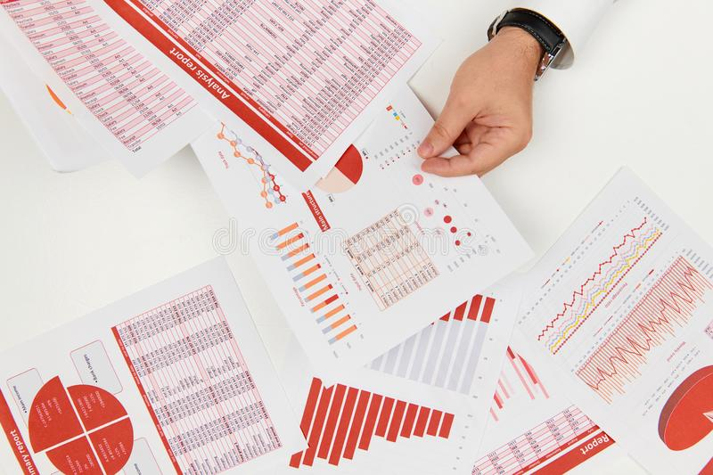 Flat top view of businessman working and calculating finance, reads and writes reports. Business financial accounting concept royalty free stock photo