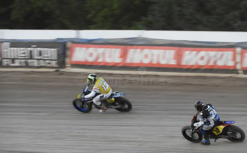 Flat Track Motorcycle Racing around an oval track stock image