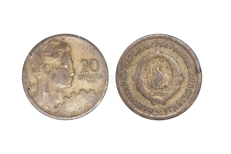 Old jugoslavija 20 dinar. A flat, typically round piece of metal with an official stamp, used as money stock photo