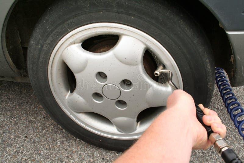 Flat tyre pump air stock image