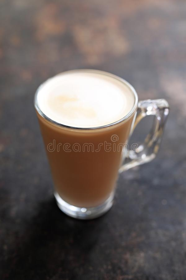 Flat white coffee with milk foam transparent glass cup stock photos