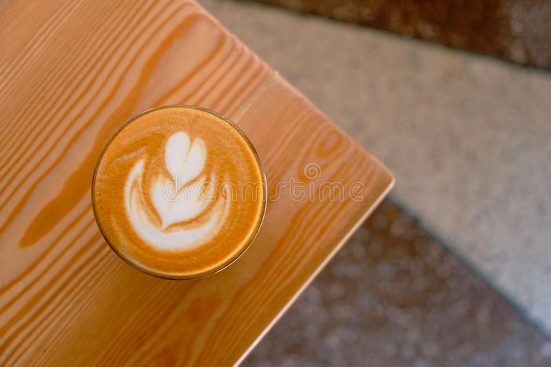 Flat white coffee on the table corner top view. Flat white coffe in transparent glass. It is espresso-based coffee drink royalty free stock images