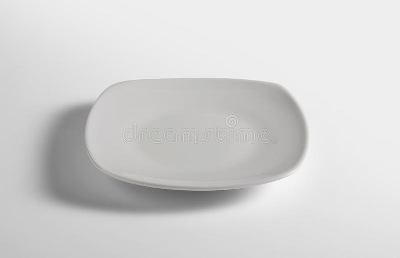 Flat white empty square plate royalty free stock photos