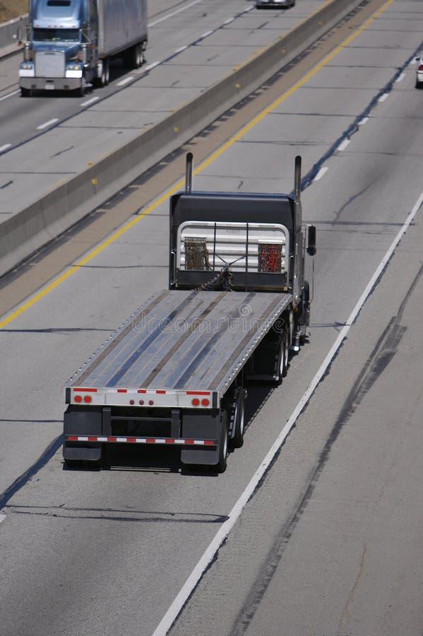 Free Flatbed Semi Truck Stock Image - 678441