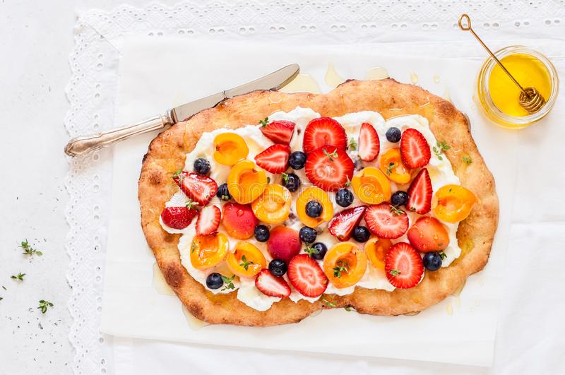 Flatbread with Ricotta, Berries and Apricots royalty free stock photo