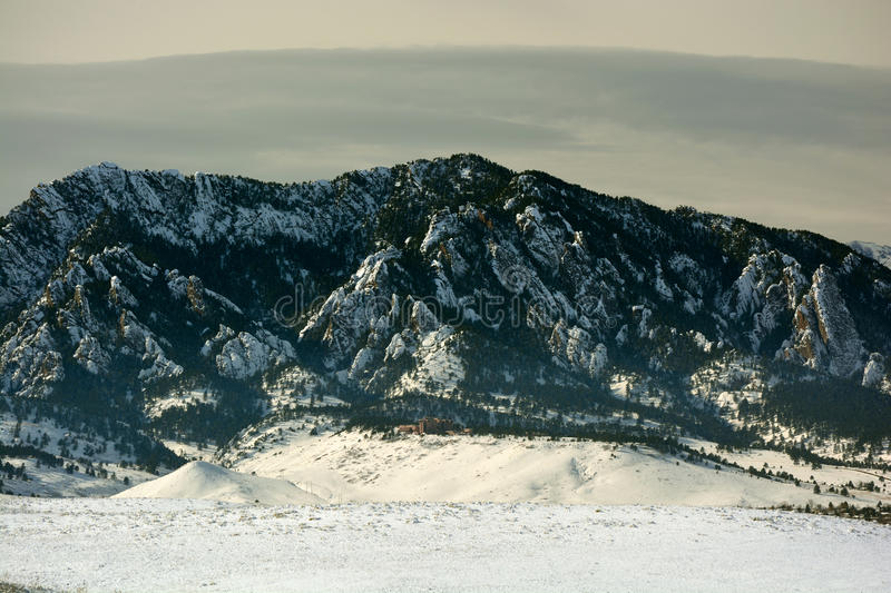 Flatirons Mountains in Boulder, Colorado on a Cold Snowy Winter stock photos