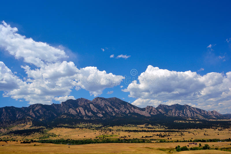 The Flatirons Mountains in Boulder, Colorado on a Sunny Summer D royalty free stock photography