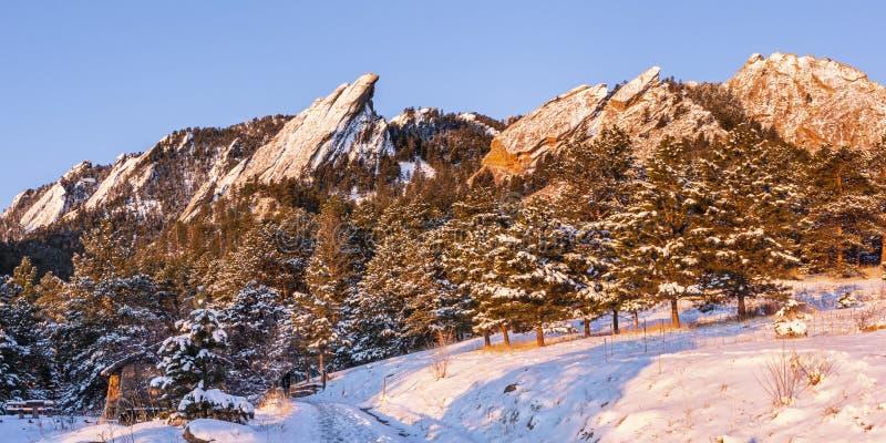 Flatirons Sunrise with Fresh Snow stock image