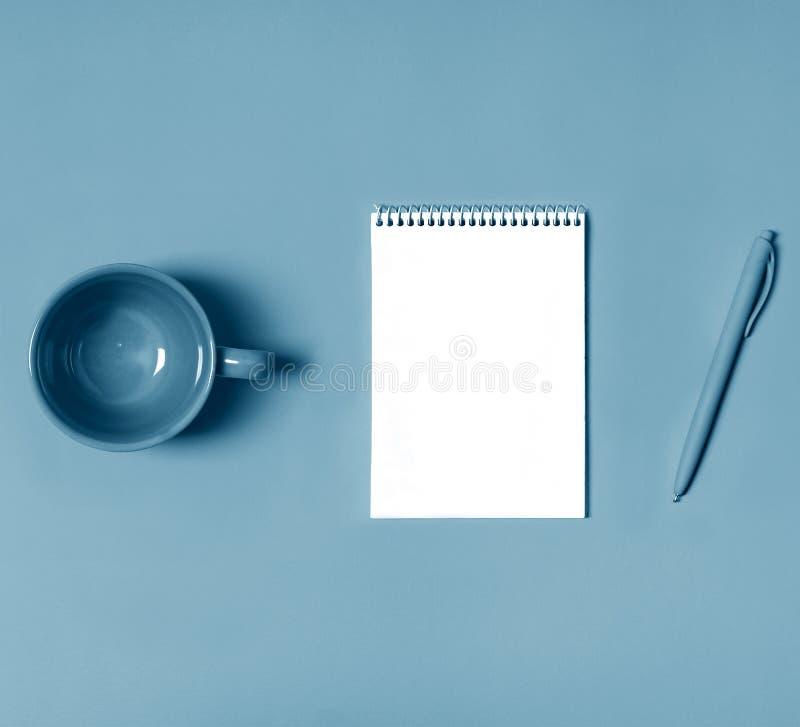 Flatlay, art minimalism style photographer stillife concept paper tablet pen design desktop idea inspiration. Flat lay, blank notepad page, empty cup, pen on stock photos