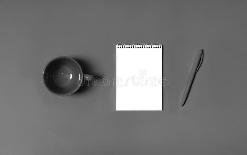 Flatlay, art minimalism style photographer stillife concept paper tablet pen design desktop idea inspiration. Flat lay, blank notepad page, empty cup, pen on royalty free stock photography