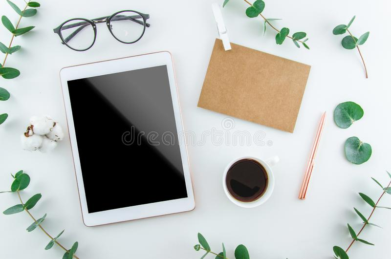 Flatlay digital tablet blank screen on work desk with glasses and coffee stock photo