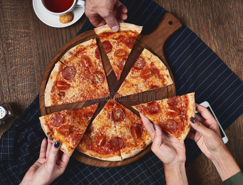 Flatlay. Friends eat pizza. royalty free stock image