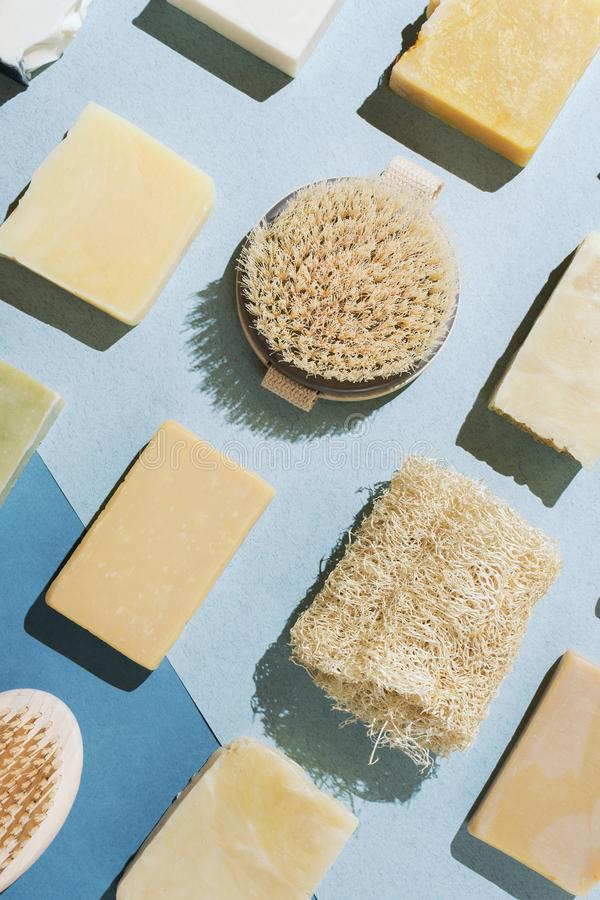 Flatlay of various natural handmade soap, body brushes and loofah sponge stock photography