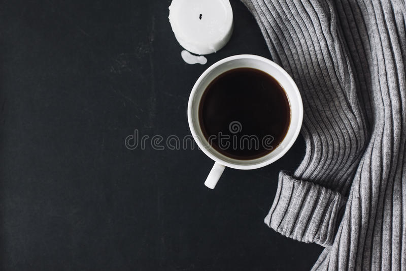 Flatlay of winter sweater and coffee stock photography