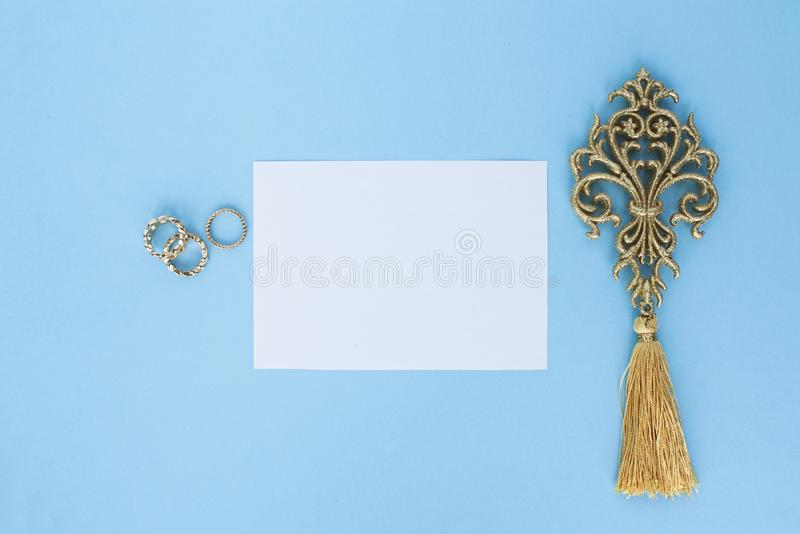 Flatley on turquoise background with white paper sheet for text and fern leaves, top view, space for text, copy space, stock photos