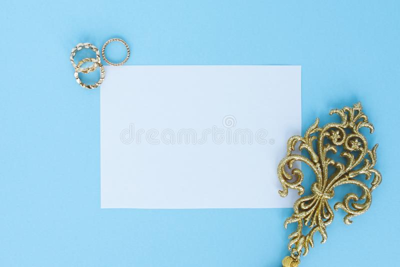 Flatley on turquoise background with white paper sheet for text and fern leaves, top view, space for text, copy space, stock photo