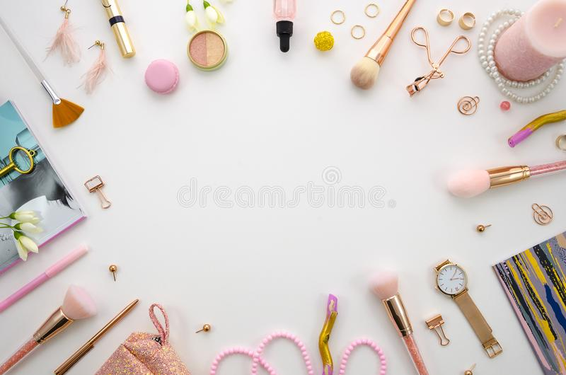 Beauty frame composition with cosmetics, makeup tools and accessory on white background. fashion, party and shopping stock photo