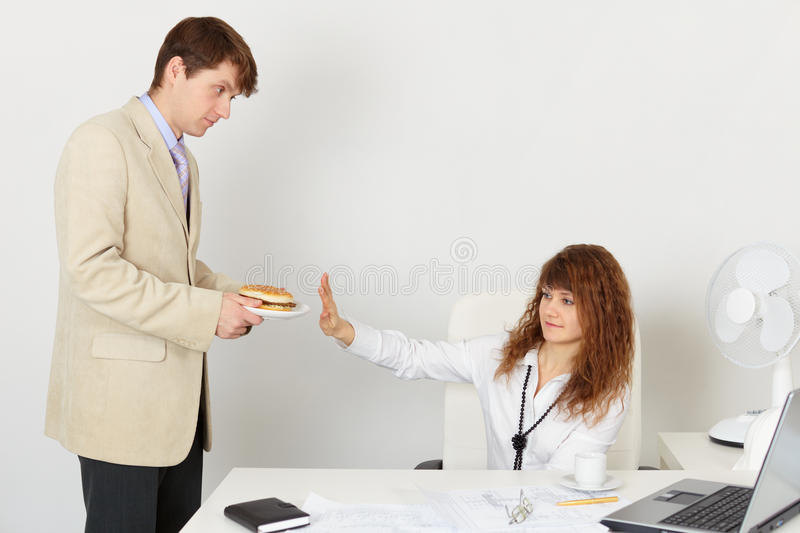 She flatly refuses to eat. At lunchtime stock images