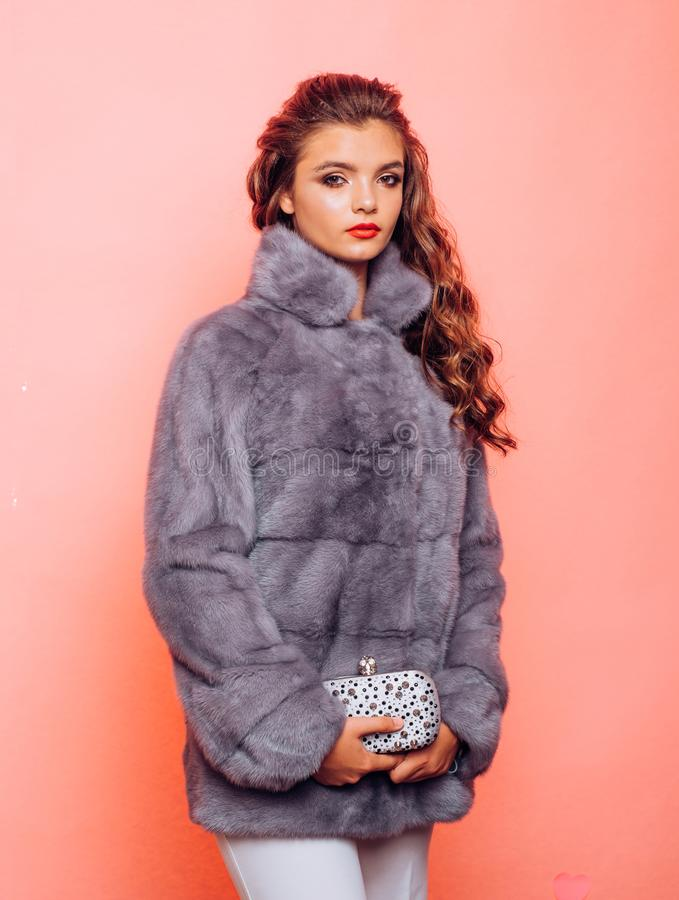 A flattering fit for the cold. Young woman wear elegant winter coat. Winter fashion trends. Perfect for winter cold. Pretty woman in fashionable fur coat royalty free stock images