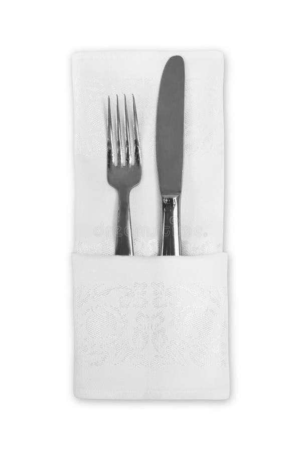 Flatware e guardanapo de linho branco fotografia de stock