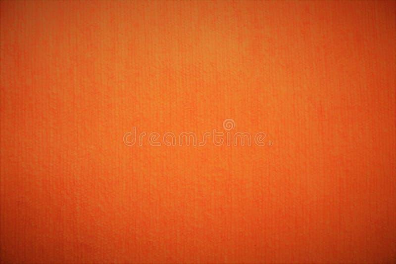 Flaumige Hintergründe des orange Textilsamt-Gewebes stockfotos