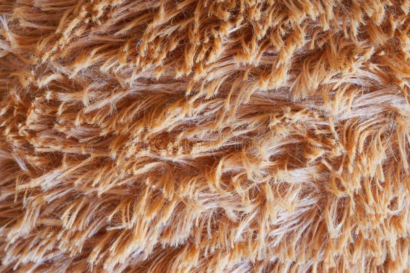 Flauschig und flockig warme Stoffe Hellbrauner Hintergrund oder Hintergrund Tageslicht lizenzfreies stockbild