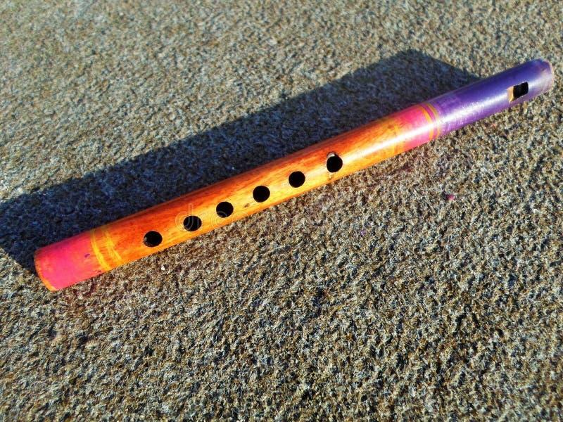 Flauto di legno con un'ombra fotografia stock