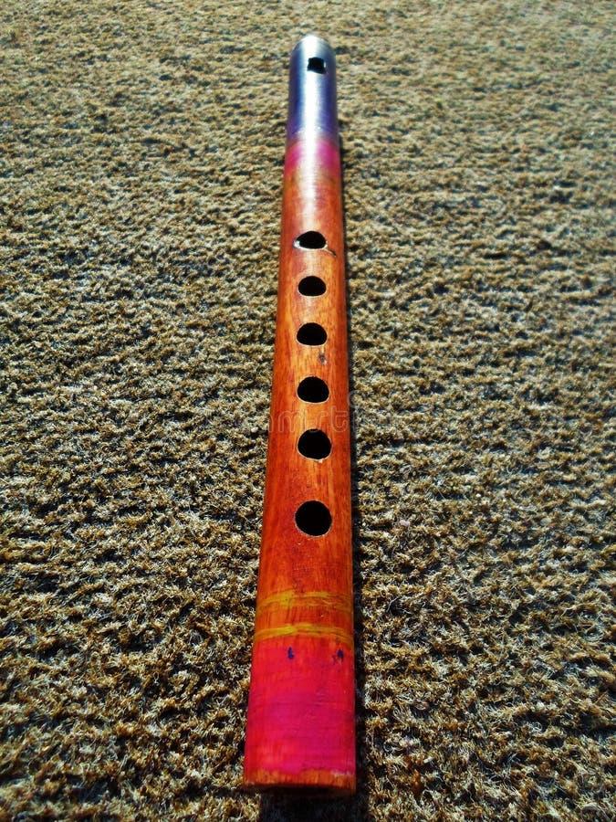 Flauto di legno su fondo non liscio fotografia stock libera da diritti