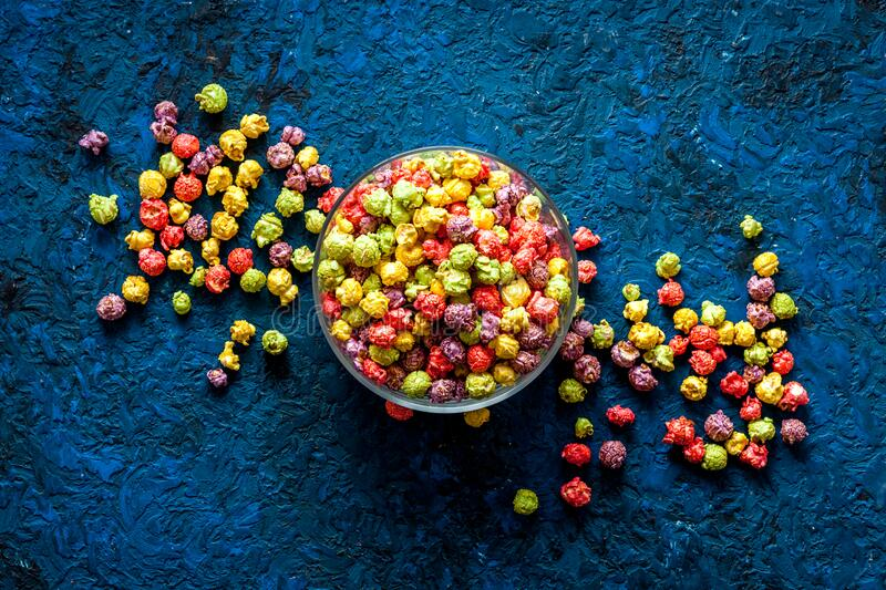 Flavored popcorn on blue table top view royalty free stock image