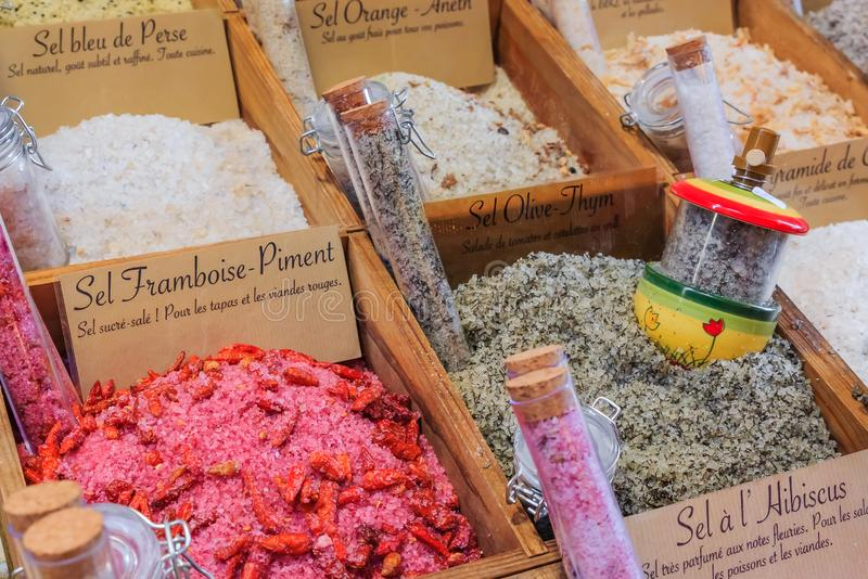 Flavored salts for sale with a handwritten signs at a local outdoor farmers market in Nice, France. Exotic flavored salts with thyme, orange, strawberry chili stock photos