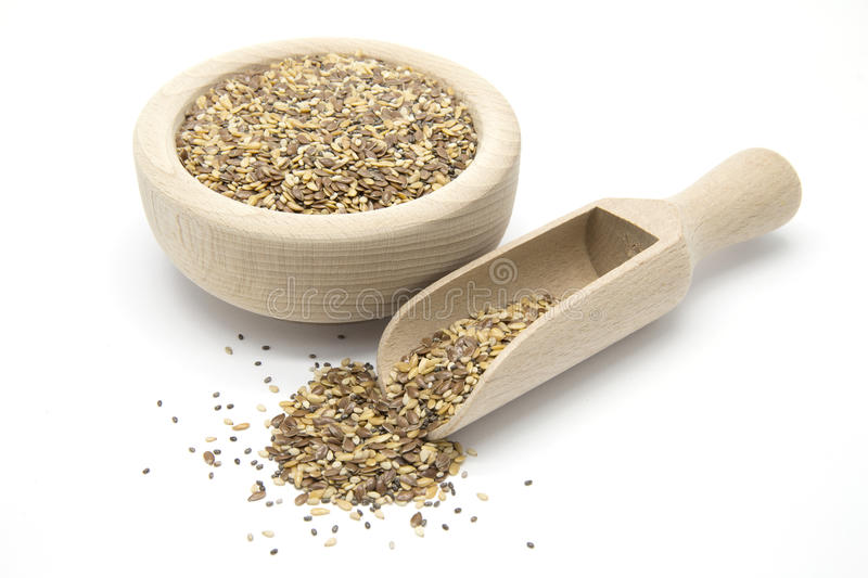Flax, chia and sesame seeds in wooden scoop and bowl. On white isolated background stock photo