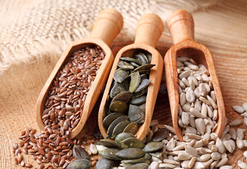 Flax, pumpkin and sunflower seeds stock photos