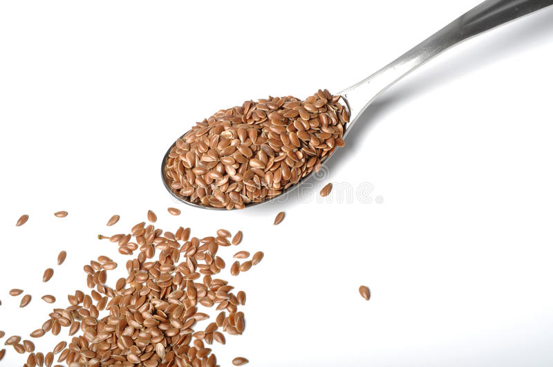 Flax seed. On a spoon stock photography