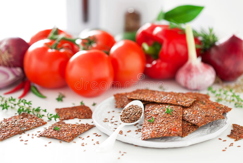 Flax seed and vegetables crackers royalty free stock image