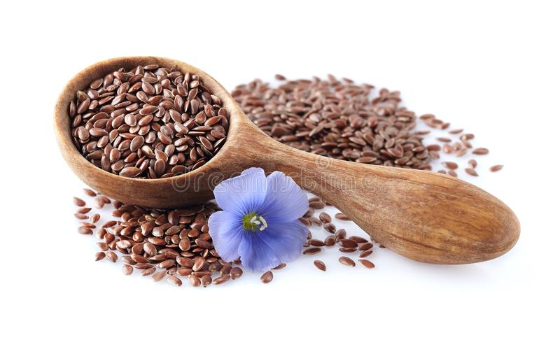 Flax seeds with flower stock images