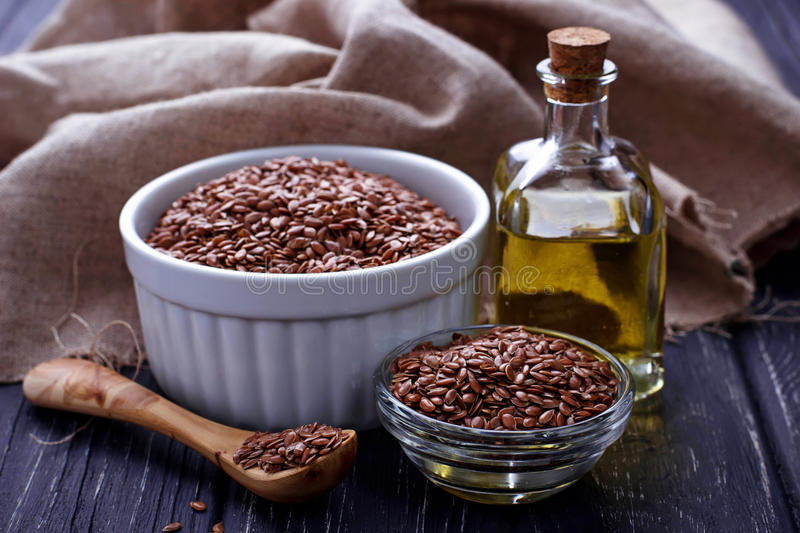 Flax seeds and linseed oil. Selective focus royalty free stock photo