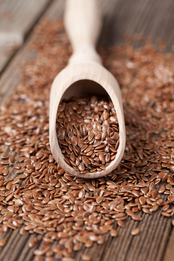 Flax seeds with omega fat in spoon royalty free stock photo