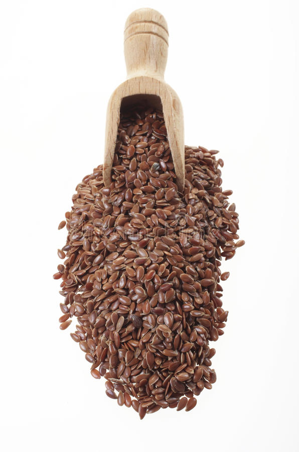 Flax seeds with a small wooden spoon. royalty free stock photo