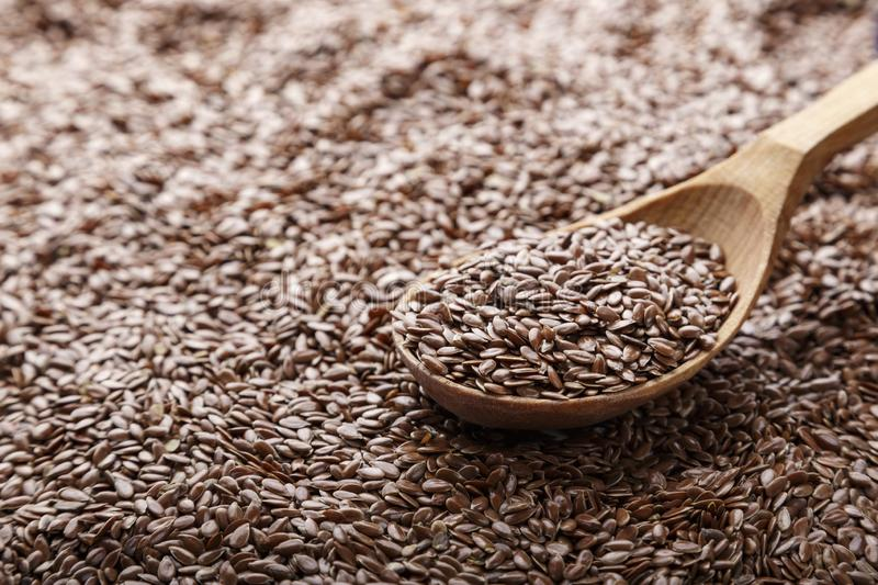 Flax seeds in a spoon stock photography