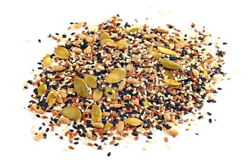Flax seeds, sunflower seeds, sesame, chia and pumpkin seeds on white background royalty free stock images