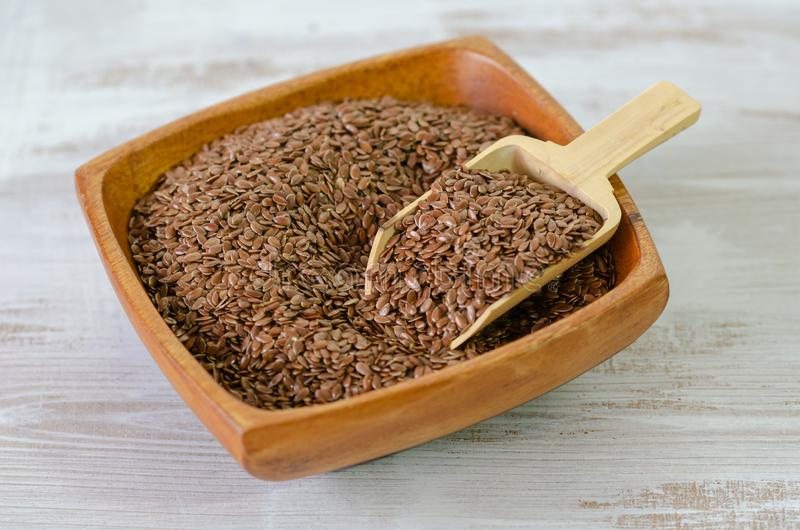 Flax seeds in wooden bowl royalty free stock photography