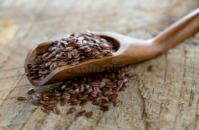 Flaxseeds in wood spoon royalty free stock image