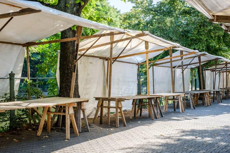 Flea market / empty market stall - outdoor market stands stock photography